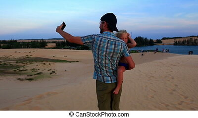 Father Holds Small Girl Photos Dunes by Lake at Sunset -...