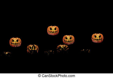 Halloween night - The Pumpkins floating in darknesson on...