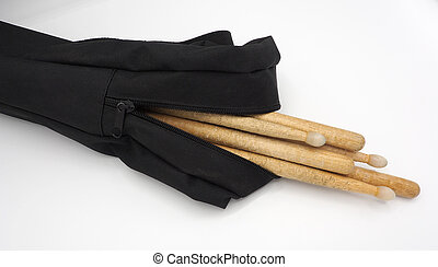Drum sticks and black bags. - Drum sticks and black bags on...