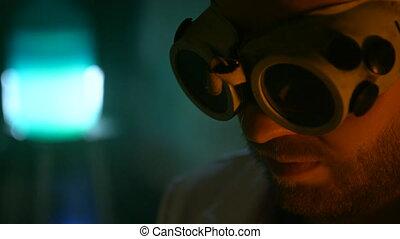 Strange scientist ignites the gas burner in the underground...