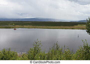 Fisherman on the klamath - View of a man fishing in a lake...