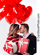 Couple with heart shaped balloons