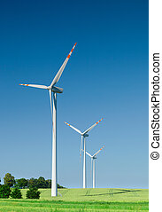 three wind turbines on green field