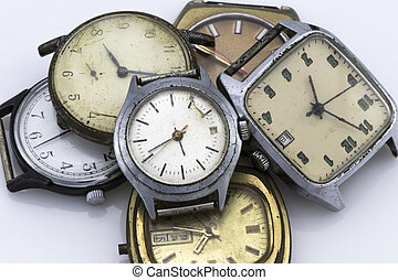 broken vintage watch, on white. - Color image of a broken...