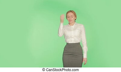 girl green background, a gesture of annoyance. language of...