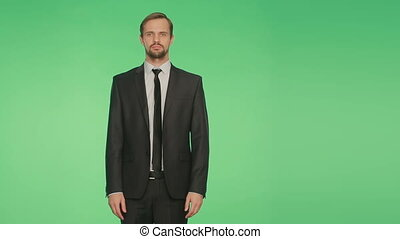 body language. man in business suit . crossed arms. green...