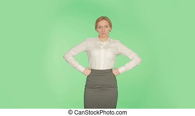 blonde girl isolated. green background. language body. hands...