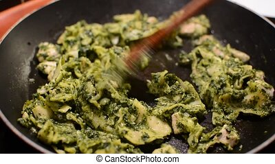 Cooking spinach pasta - Cooking and stirring a spinach pasta...