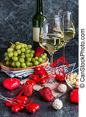 Bottle of white wine, two glasses and grapes bunch - Bottle...