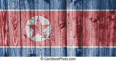 Flag of North Korea on weathered wood