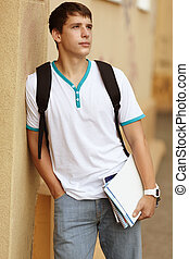 Male College Student - teenager on campus background,...