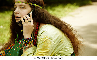 hippie on the phone - young woman with cell-phone ,toned...