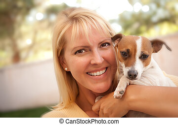 Attractive Woman and Her Jack Russell Terrier Dog Outdoors...
