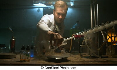 The scientist collects gas in the flask after the experiment...