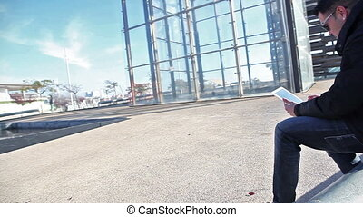 Mobile devices lifestyle.Internet concept - Man sitting in...