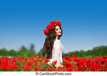 Enjoyment. Beautiful carefree brunette woman with long healthy hair running on red poppies field nature background. Wellness well-being happiness concept.