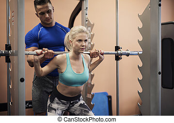 Woman working at muscular build