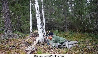 Hunter man shoots from a gun 1080