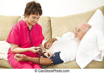 Home Nurse Takes Blood Pressure - Friendly home health nurse...