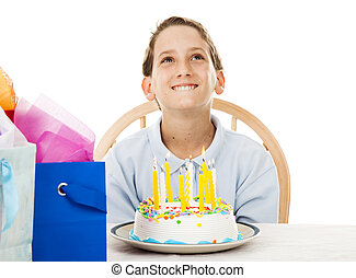 Birthday Boy Makes a Wish - Cute little boy making a...