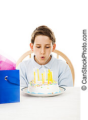 Blowing Out Birthday Candles - Little boy blows out the...