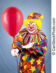Clown Offers Balloon - Happy birthday clown holding out a...