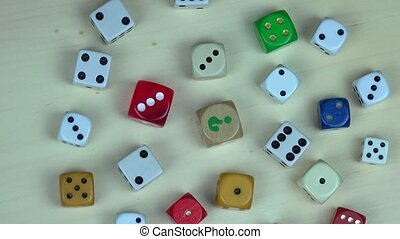Colorful dices on wooden background. turntable counterclockwise