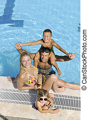 happy young family have fun on swimming pool at summer...