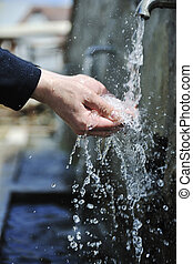 fresh mountain water falling on hands - clear fresh mountain...