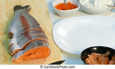 Cook cuts salmon steaks. - Chef cutting salmon for steaks....