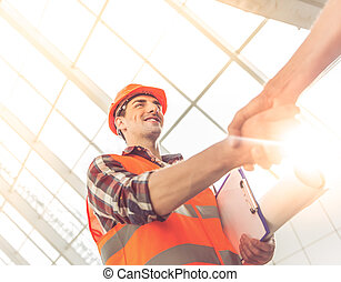 Construction Industry workers - Handsome construction...