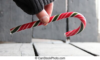 Candy cane, Winter and Christmas time concept. - Hand...