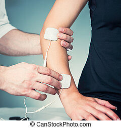 Positioning TENS electrodes - Physical therapist positioning...