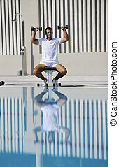 young healthy athlete man exercise at poolside