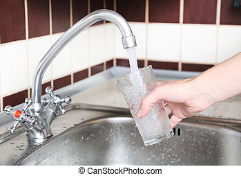 Glass filled with water from faucet