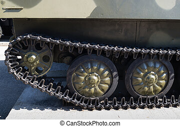 Tracks and wheels of military equipment. Exhibited on a...