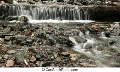 Small Waterfall On Mountain River