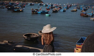 beautiful woman see on Traditional fishing boat on small waves. Vietnam hd