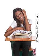 Black college student woman with book by desk - High school...
