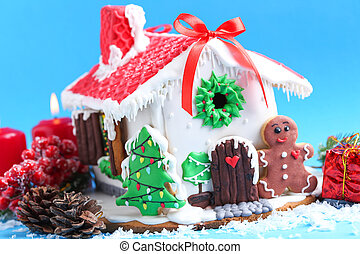 Christmas gingerbread house on blue background