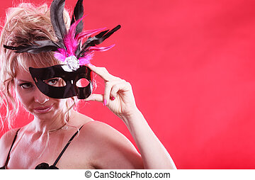 Woman with carnival mask.