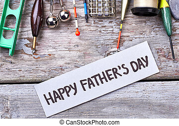 Happy Father's Day greeting paper. Fishing tackle near card....