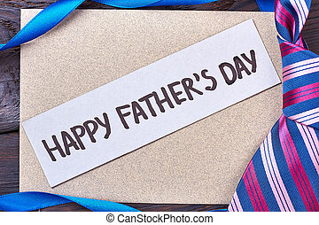 Father's Day card near tie. Ribbon and greeting card....