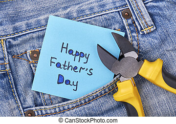 Pliers near Father's Day card. Jeans pocket with pliers....