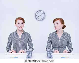 Happy and sad worker sitting beside desk