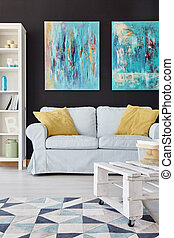 Living room decor - Modern living room decor with paintings...