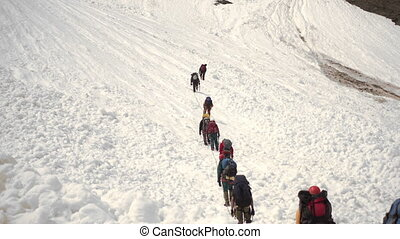 Climbers walk - Climbers go up  to the mountain pass. 4K