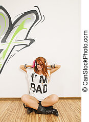 Cool hip-hop dancer listening to the music