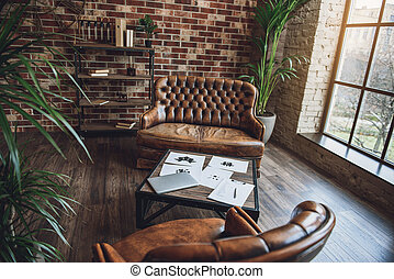 Room furnished in loft style - Working of psychologist....