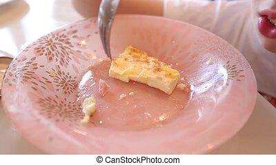 child eating an omelet